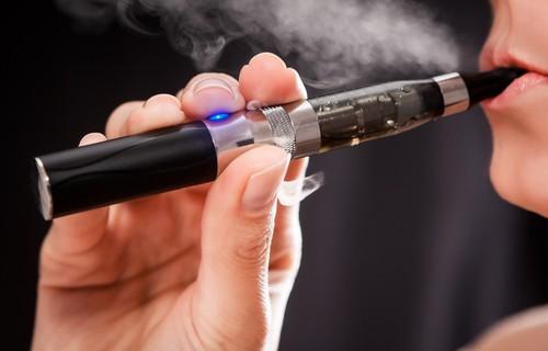 man smokes e-cig